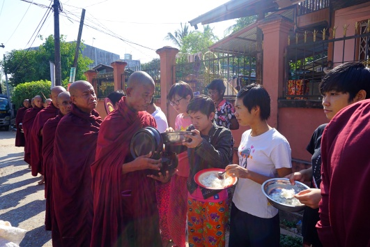 Collecting the alms is a daily task for monks